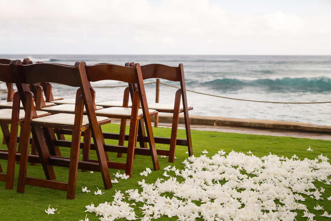 chairs set up foe wedding ceremony by the beach