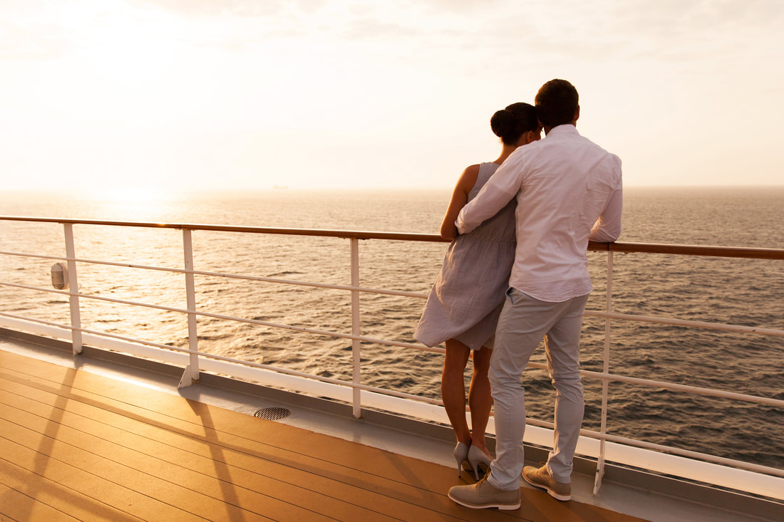 couple embracing on cruise ship during sunset